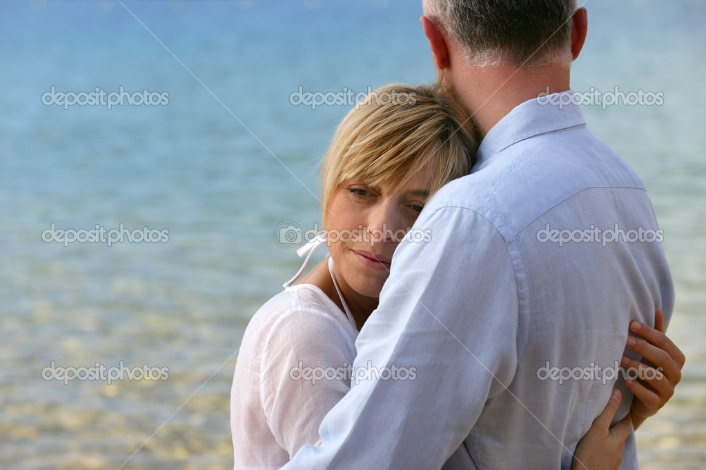 Blonde woman hugging her husband  Stock Photo #8678239