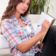 Woman writing in a book — Stock Photo #8685810