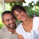 pareja sentada en la hamaca — Foto de Stock   #8686288