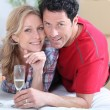 Newlyweds celebrating new home — Stock Photo