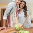Couple making a salad in the kitchen — Stock Photo #8687392