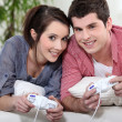 Stock Photo: Young couple playing video games
