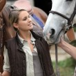 Portrait of a young woman with horses — Stock Photo