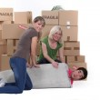Three friends moving house — Stock Photo