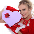 Mrs Claus with box of chocolates — Stock Photo #8688184