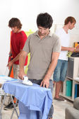 Men housemates doing daily chores — Stock Photo