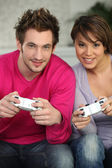 Young couple playing a games console — Stock Photo