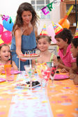 Time to blow out the candles at a child's birthday party — Stock Photo