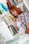 Student revising in library — Stock Photo