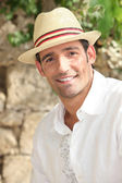 Summery man in a straw hat — Stock Photo