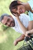 Couple riding their bikes together — Stock Photo