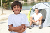 Young boy camping with his dad — Stock Photo