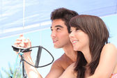 Young couple sailing in the summer — Stock Photo