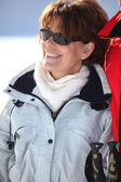 A smiling mature woman in a winter sports resort — Stock Photo