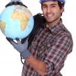 Stock Photo: Electrician with a globe