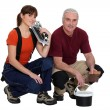 Stock Photo: Team of tile fitters