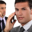 Stock Photo: Businessmen talking on their mobile phones
