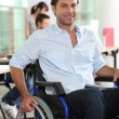 Businessman in a wheelchair — Stock Photo