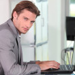 Young businessman on laptop — Stock Photo #8693803