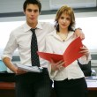Stock Photo: Two young business with folders