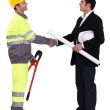 An engineer shaking hands — Stock Photo #8695839