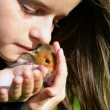 Little girl with her pet hamster - Stock Photo