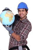 Electrician with a globe — Stock Photo