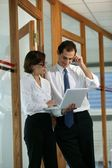 Office workers in discussion — Stock Photo