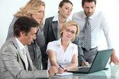 Businessteam around a laptop — Stock Photo