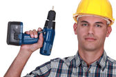 Artisan with drill — Stock Photo
