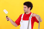 Man with step-ladder using paint-roller — Stock Photo