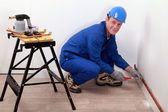 Professional repairman working on a wall — Stock Photo