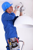 Electrician shutting off the power — Stock Photo