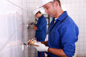 Electrician using a voltmeter — Stock Photo