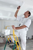 Craftsman painting the ceiling — Stock Photo