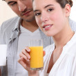 A nice couple having morning drinks. — Stock Photo
