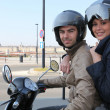 Young couple on scooter - Stock Photo