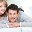 Cute couple relaxing at home — Stock Photo