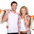 Couple with bags — Foto de Stock
