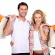 Couple with bags — Stock Photo