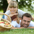 Couple having a picnic in the woods — Stock Photo