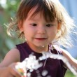 Toddler playing with garden hose — Stock Photo