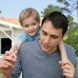 Father and son playing in the garden — Stock Photo