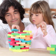 Father and child playing a game together — Stock Photo #8756470