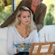 Woman painting as mother watches — Stock Photo #8756538