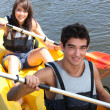 Stock Photo: Couple paddling in canoe