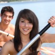 Stock Photo: Young couple in canoe