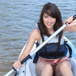 Photo: Young brunette in kayak