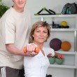 Personal trainer helping his client with her posture — Stock Photo #8758771