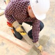 Stock Photo: Carpenter sawing wood